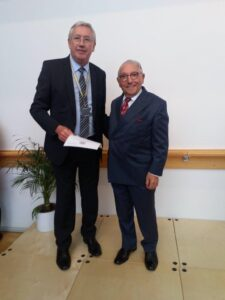 John Ainley receiving his certificate from the Youth Zone's president, Sir Norman Stoller